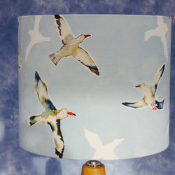 Lampshade featuring gulls in flight.