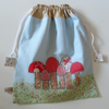 Drawstring bag with toadstool applique