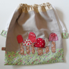 Drawstring fabric bag with appliqued toadstools