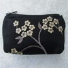 Black purse with sprays of pale yellow flowers