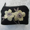 Black purse with pale yellow flowers
