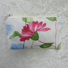 Small purse in cream, pink, blue and green floral fabric