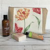 Beige toiletry bag, wash bag with floral panel featuring Parrot Tulips