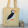 Puffin tote bag in pale golden yellow with black and white polka dot Puffin