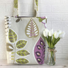 Stylised leaves tote bag in pale beige with green and purple foliage print