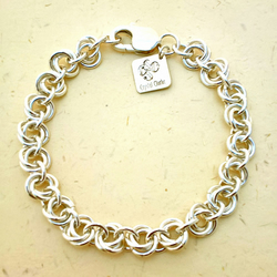 Sterling silver chainmaille bracelet in a lovely mobius flower weave