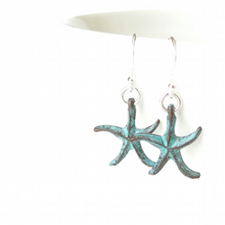 Starfish earrings with sterling silver ear wires and green patina charms