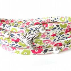 Liberty fabric bracelet with hummingbird charm in spring green and pink