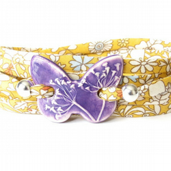 Purple clay butterfly wrap with yellow Liberty ribbon