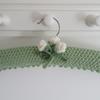 Soft green ladies coat hanger with cream buds