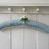 Hand knitted ladies coat hanger, blue with rose buds