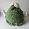 Hand knitted green tea cosie with cream roses
