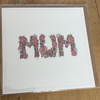 The word 'Mum' written in flowers Greeting card