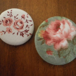 PAIR OF ROSE FABRIC BADGES