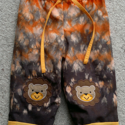 Pull-up Trousers with Lion applique