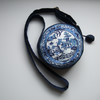 Circular shoulder bag made from a vintage willow pattern plate embroidery