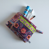 Toiletries or make up bag made from a Folk Art style print.