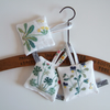 A Set of 3 lavender bags with vintage botanical embroidery.