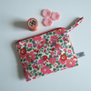 Liberty print zip up makeup bag or purse, with pink flowers.