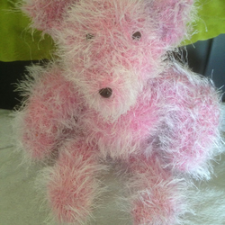 Hand knitted pink teddy bear