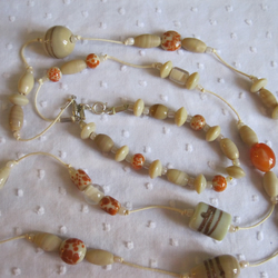 Long beaded necklace and bracelet in neutral colours at special price