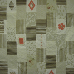 Patchwork throw in shades of coral and taupe