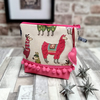 Llamas design tapestry and 'oilcloth' makeup bag.
