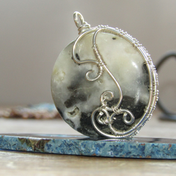 Wire wrapped coin pendant