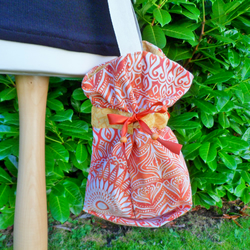 Orange patterned boho bucket bag