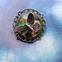 Japanese Decorative Flowers and Birds Brooch with Butterfly Embellishment.