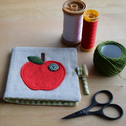 REDUCED Linen Needle Book - appliqued red felt apple with green spotty button.