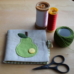 REDUCED Linen Needle Book - appliqued green felt pear with yellow spotty button.