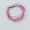 Pink and lilac bangle with three strands of mesh tube and silky cord.