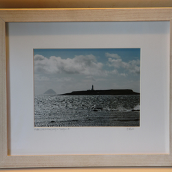 Framed photo of Pladda Lighthouse with Ailsa Craig in background