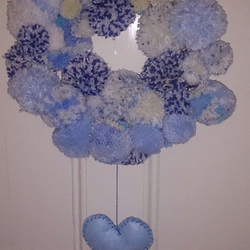 Unique Handmade PomPom wreath in shades of blue with ribbon trim