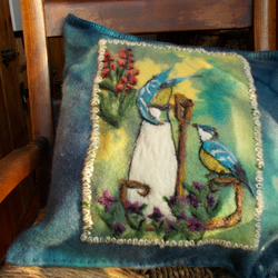 Pure wool cushion cover, felted and hand-dyed blue-green with blue tit design