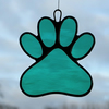 Paw Print suncatcher in teal green rippling water glass