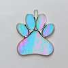 Paw Print suncatcher in blue translucent iridescent glass