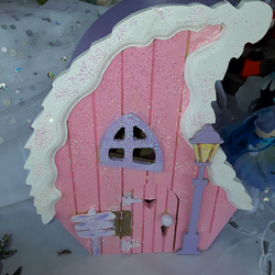 Wooden decorated fairy house with mini fairy doll