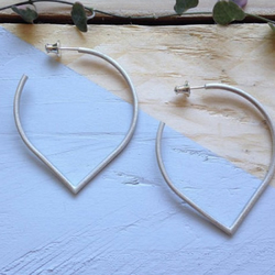 Large lotus petal hoop earrings in recycled sterling silver.
