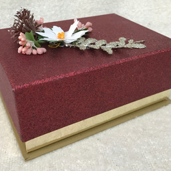 Beautiful burgundy and gold box filled with tealights and votives