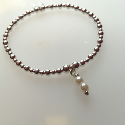 Sterling Silver Bead stretch Bracelet with handmade cultured pearl charm