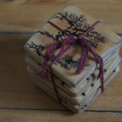 Coasters made from reclaimed wood with Lichtenberg figure decoration