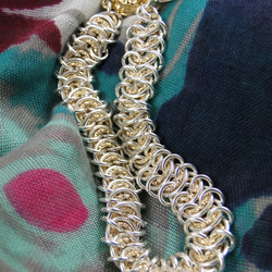 A delicate sterling silver and gold fill chainmaille bracelet.