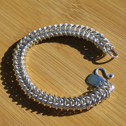 Heavy box weave sterling silver chainmaille bracelet.  Hallmarked.