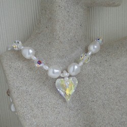 White pearl and crystal necklace with a focal crystal heart