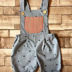 boys blue star print dungarees with red and white stripe pocket detail