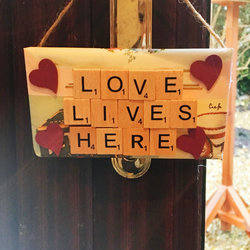 Love Lives Here Wooden Plaque