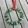 Luminesent glass wreath with berries