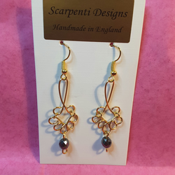 Gold plated chandelier dangle earrings with hematite beads